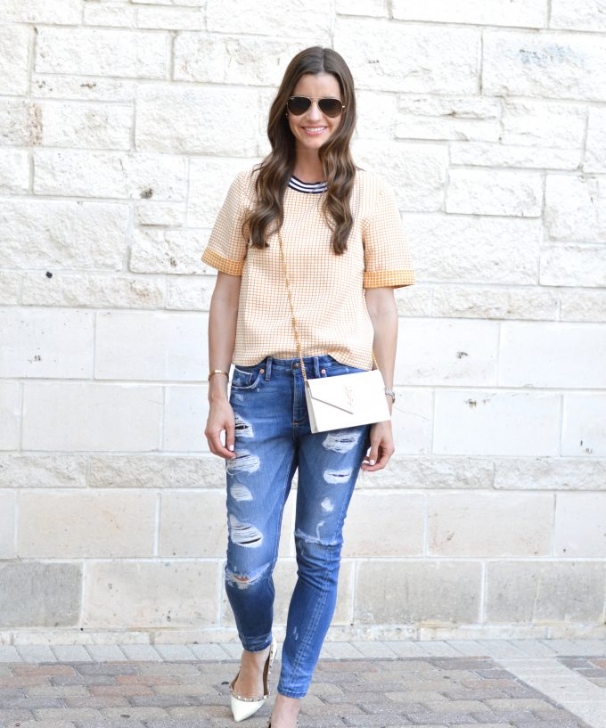 buru white label with distressed jeans and white cross body