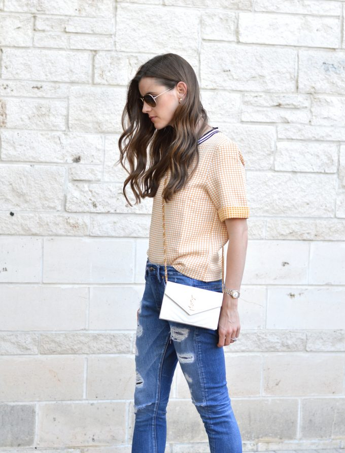 white cross body bag and yellow boxy top