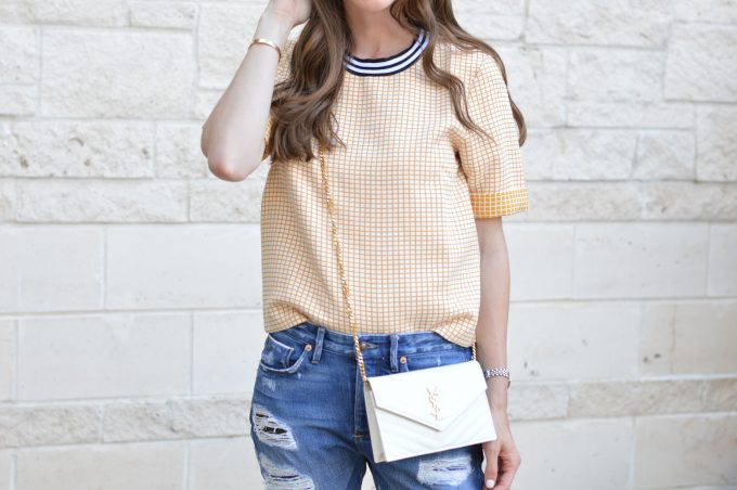 yellow checked boxy top and white cross body bag
