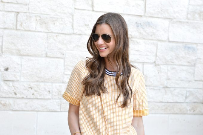 yellow check cross boxy top with black and white banded neck