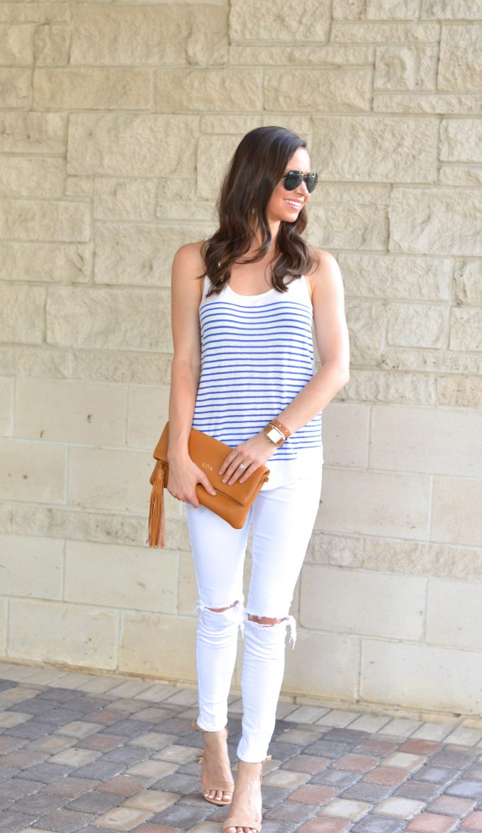A cute casual date night putfit with white distressedjeans, a striped tank and nude heels.
