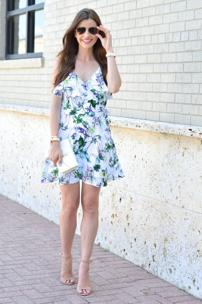 A feminine wrap dress with great details such as a ruffle neckline and pretty floral print.