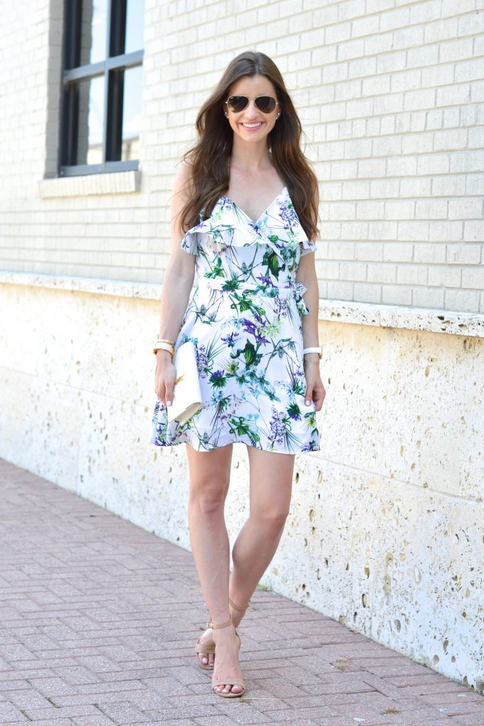 A floral wrap dress with pretty feminine detials such as a ruffle neckline and flirty skirt.