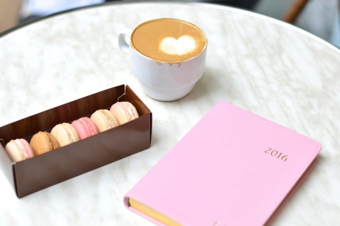 Latte art, French macarons and a pretty pink planner.