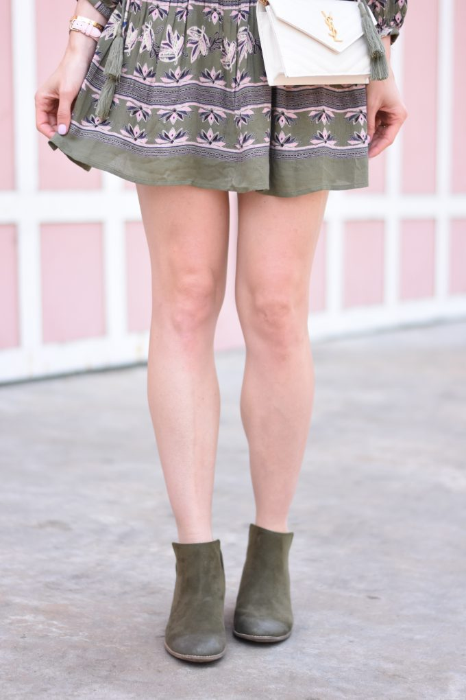 A green and blush pink boho print dress with olive green booties
