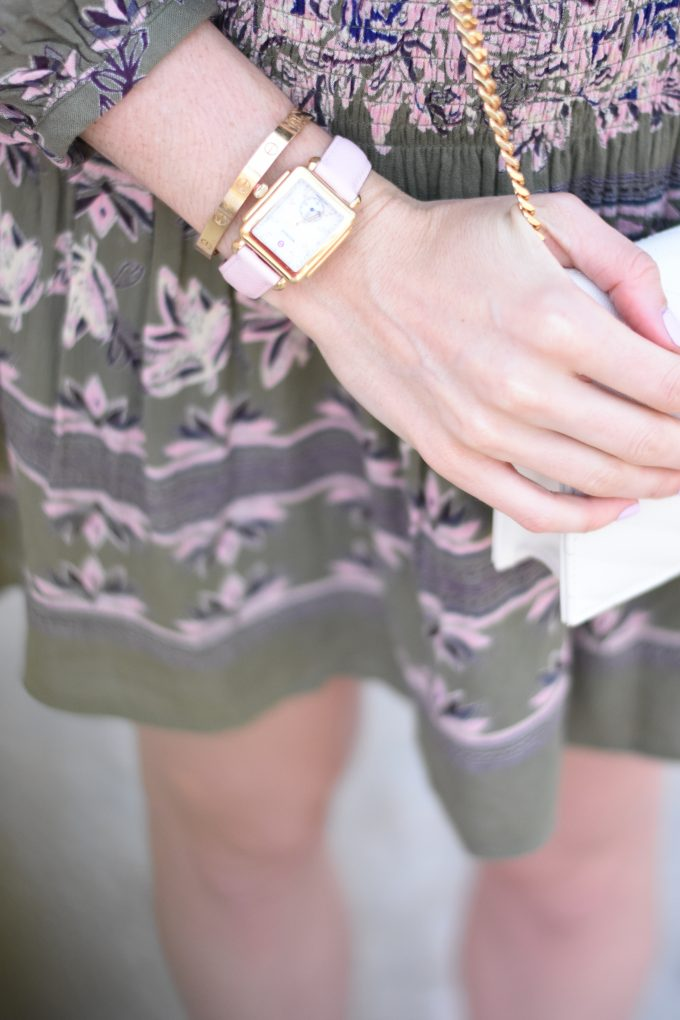A ladies gold watch with blush pink strap