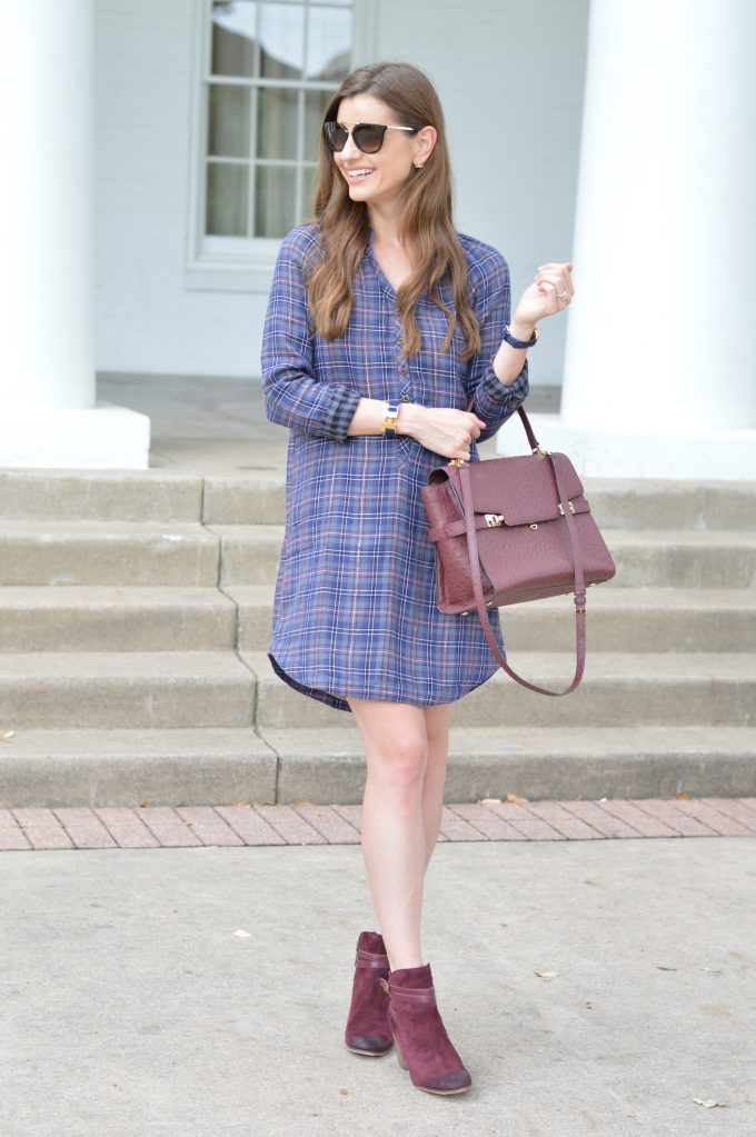 A plaid shirt dress for fall with a wine colored satchel and burgundy booties.