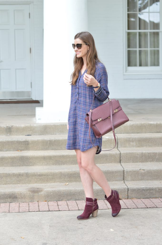 A great plaid shirtdress that's perfect for a young mother, worn with a wine colored handbag and burgundy booties.