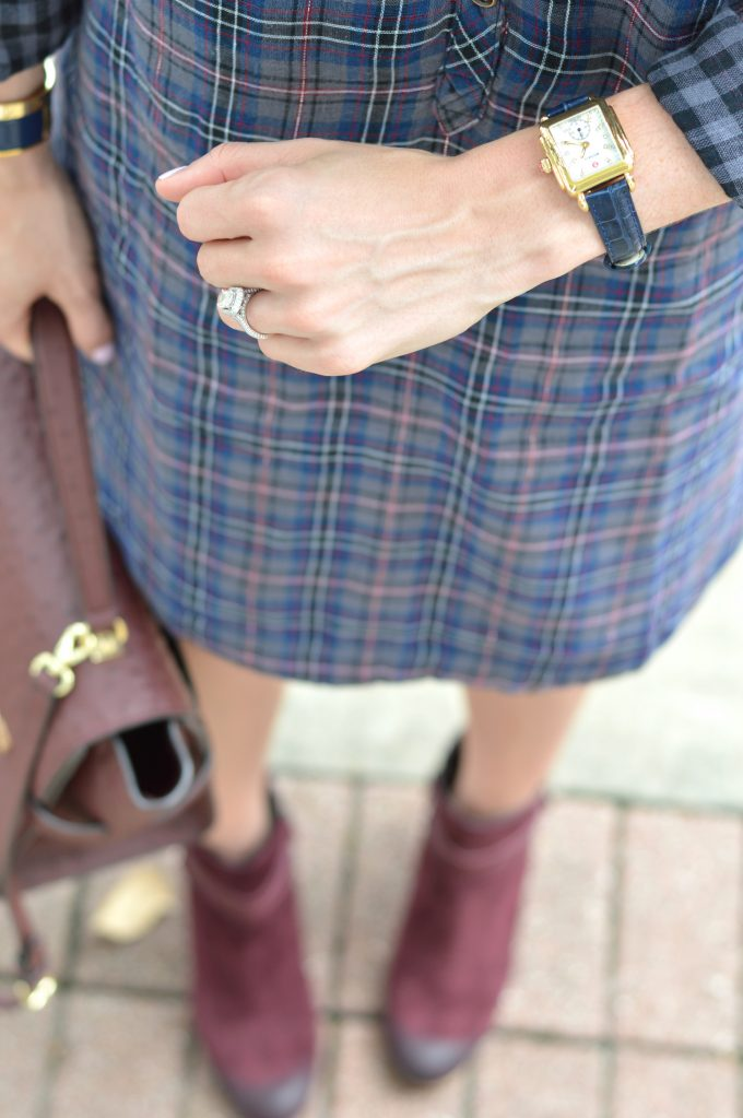 A MICHELE watch with navy alligator strap, worn with a plaid shirtdress that's a perfect look for fall.