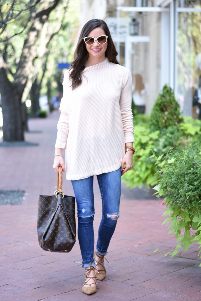 A lightweight sweater for fall in a soft blush pink