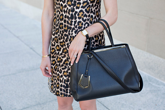A leopard print shift dress with a black tote bag