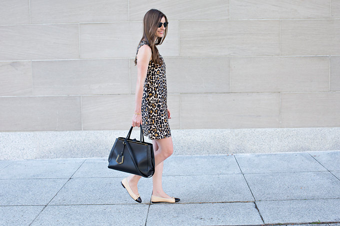 A leopard print shift dress with cap toChanel flats and a black tote bag