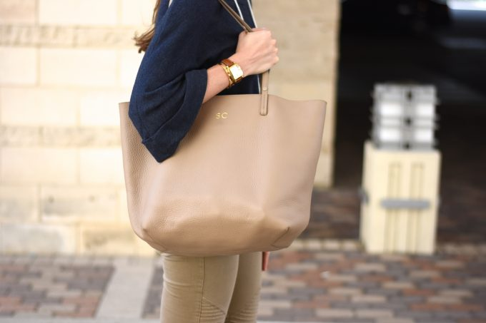 A tan leather monogrammed shopping tote.
