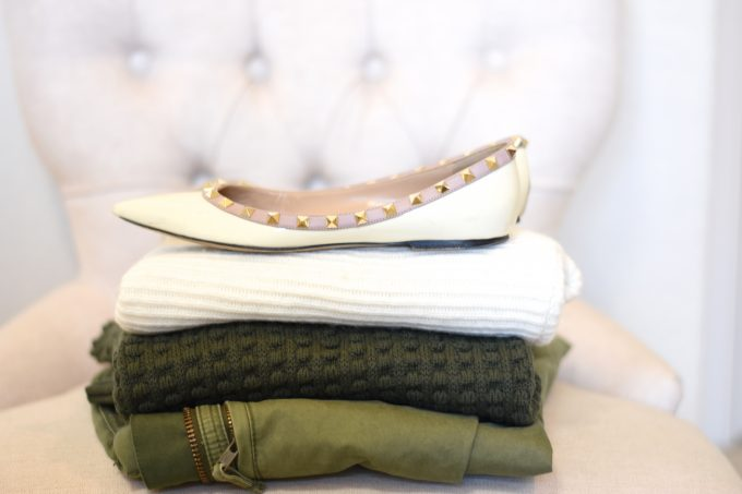 An olive green military jacket, olive green pompom sweater, cream and taupe sweater and rockstud flats to pack for Helsinkii