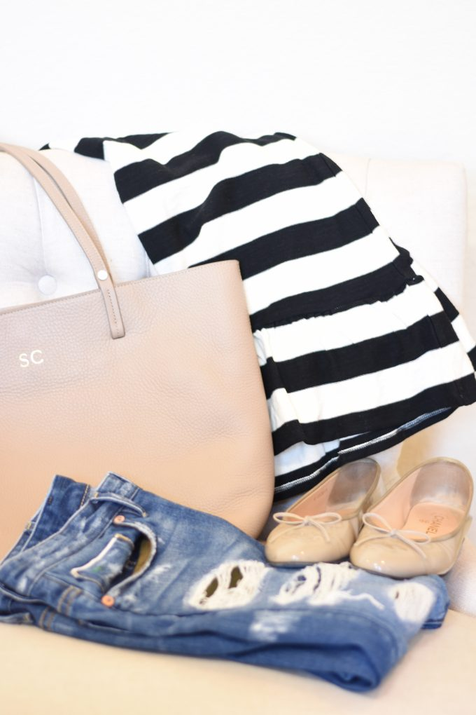A taupe tote bag, black and white stripe sweater, Chanel flats and distressed jeans for Helsinki trip