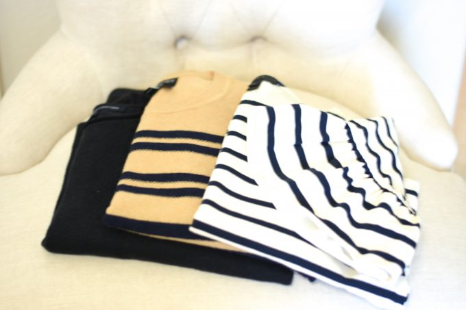Three sweaters in stripes and solid to pack for Helsinki