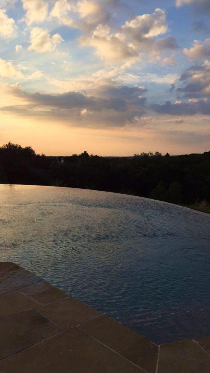 Texas sunrise overlooking an infinity edge pool