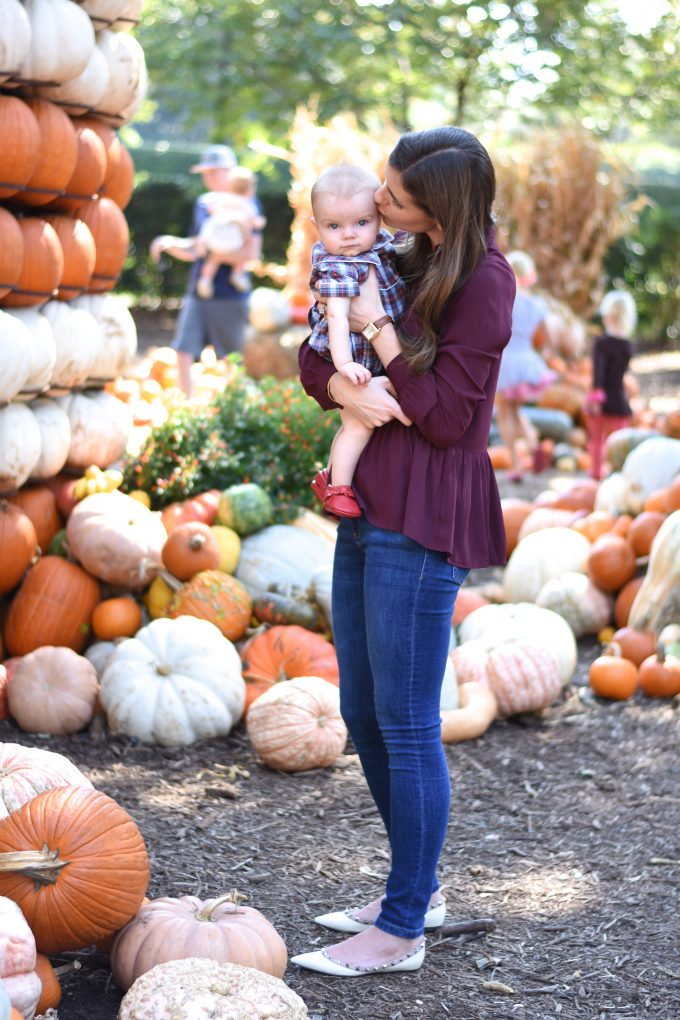 mother and baby in a pumpkin patch