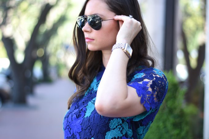 black ray bans and a MICHELE watch