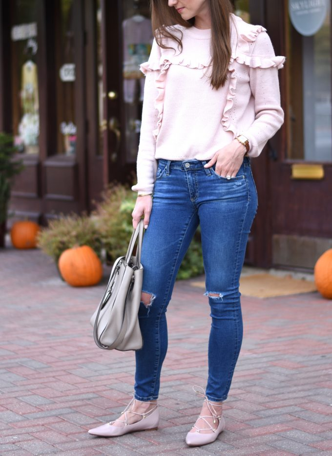 blush pink sweater, distressed jeans