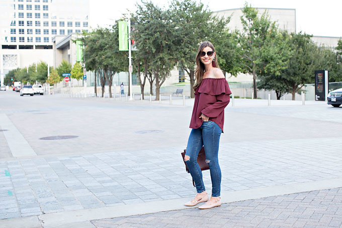 Burgundy off the shoulder top, distressed jeans and blush pink lace up flats