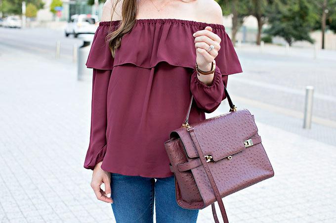 Off the shoulder top with matching burgundy handbag
