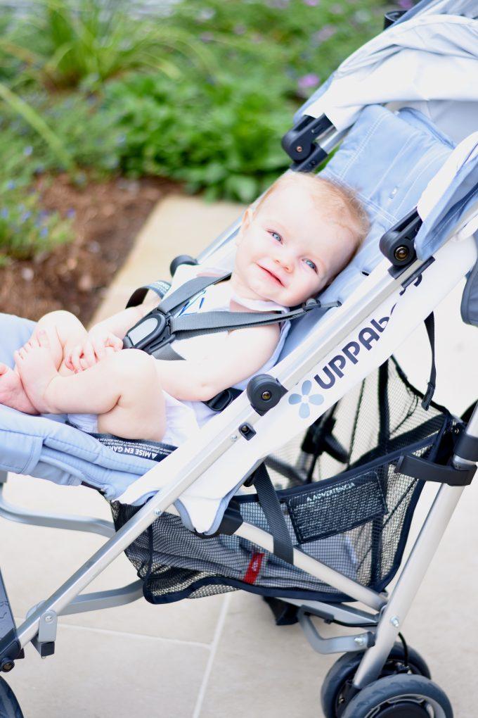 baby in an umbrella stroller