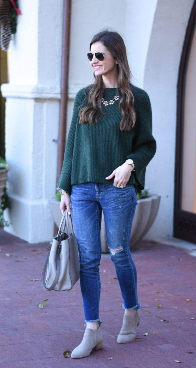 green bell sleeve sweater, grey booties, grey handbag, distressed jeans