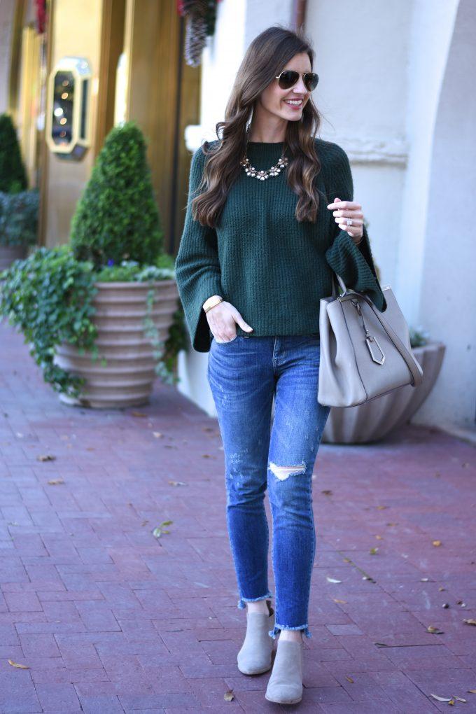 green sweater, distressed jeans, grey handbag, grey booties