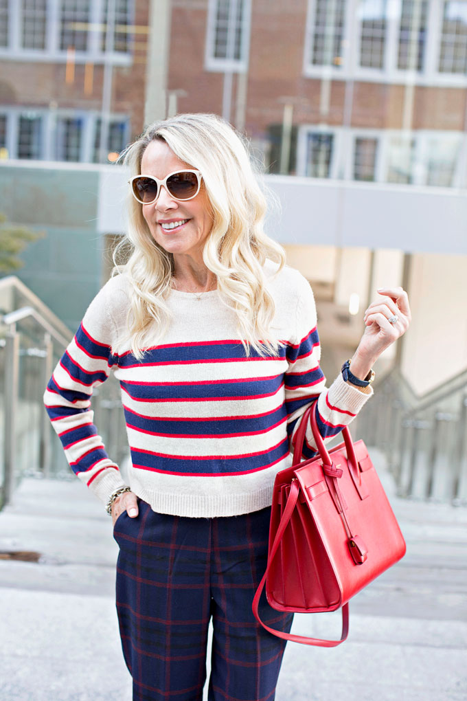red white and blue cropped sweater, red handbag
