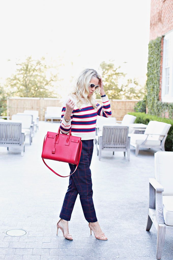 cropped striped sweater and plaid pants, red handbag