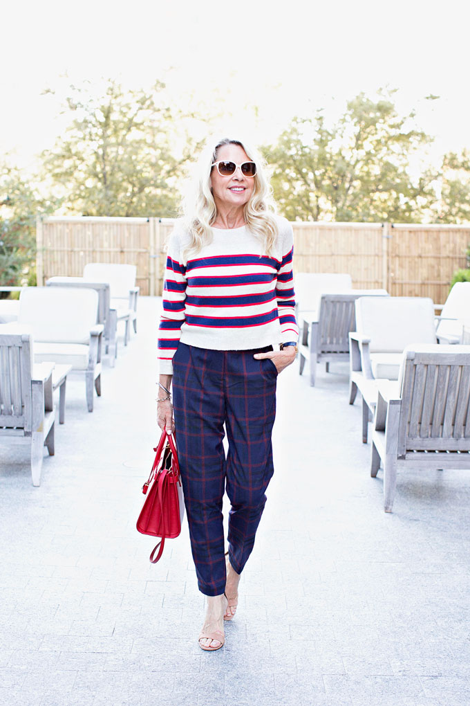 mixing prints with a striped cropped sweater and plaid high waisted pants