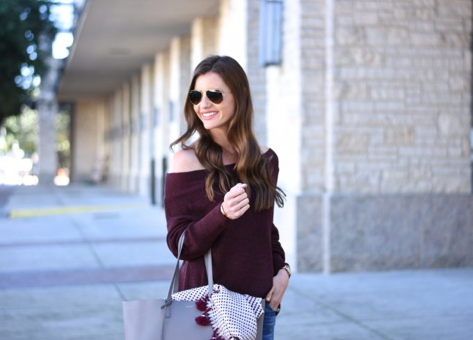 burgundy off the shoulder sweater, pom pom scarf, grey tote bag