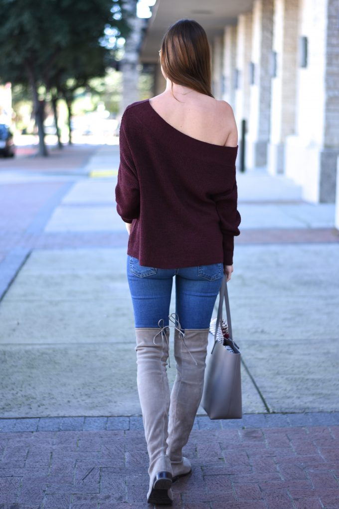 burgundy off the shoulder sweater, grey over the knee boots, grey tote bag