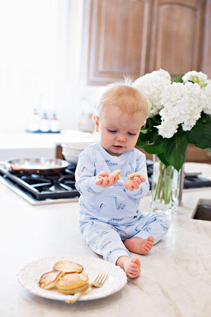 baby eating pancakes