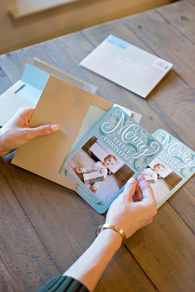 assembling personalized Christmas cards
