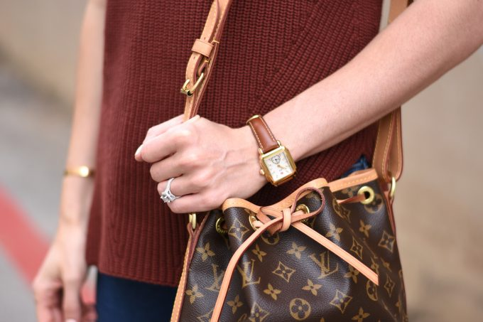 gold watch with brown dtrap, Louis Vuitton handbag