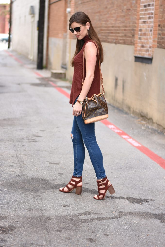 sleeveless sweater in oxblood, strappy burgundy sandals, Louis Vuitton shoulder bag