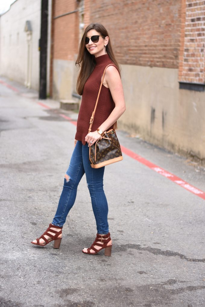 Sleeveless sweater, distressed jeans, strappy sandals for fall