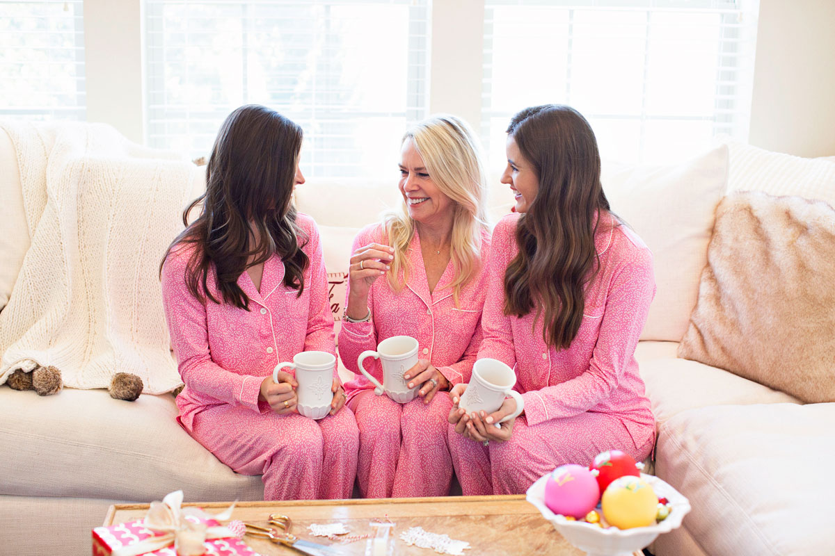 pink Christmas pajamas, white coffee mugs