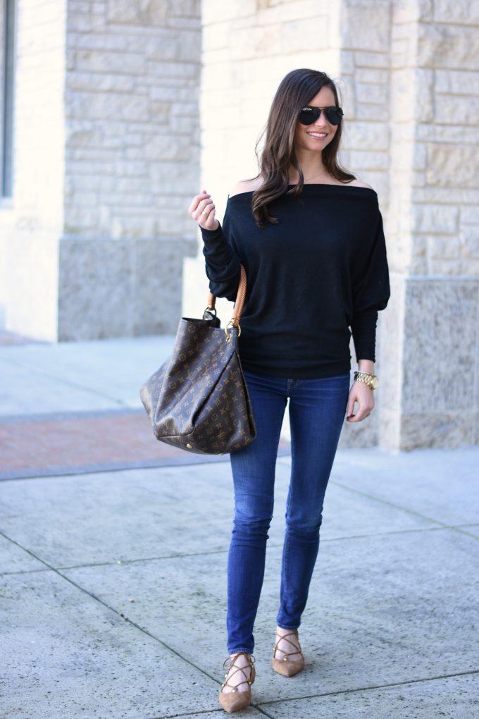 black off the shoulder sweater, hobo bag, jeans, lace up flats