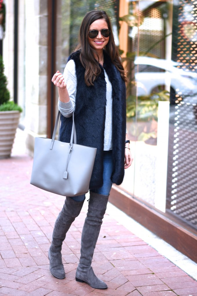 grey tote bag, greu over the knee boots, blue faux fur vest