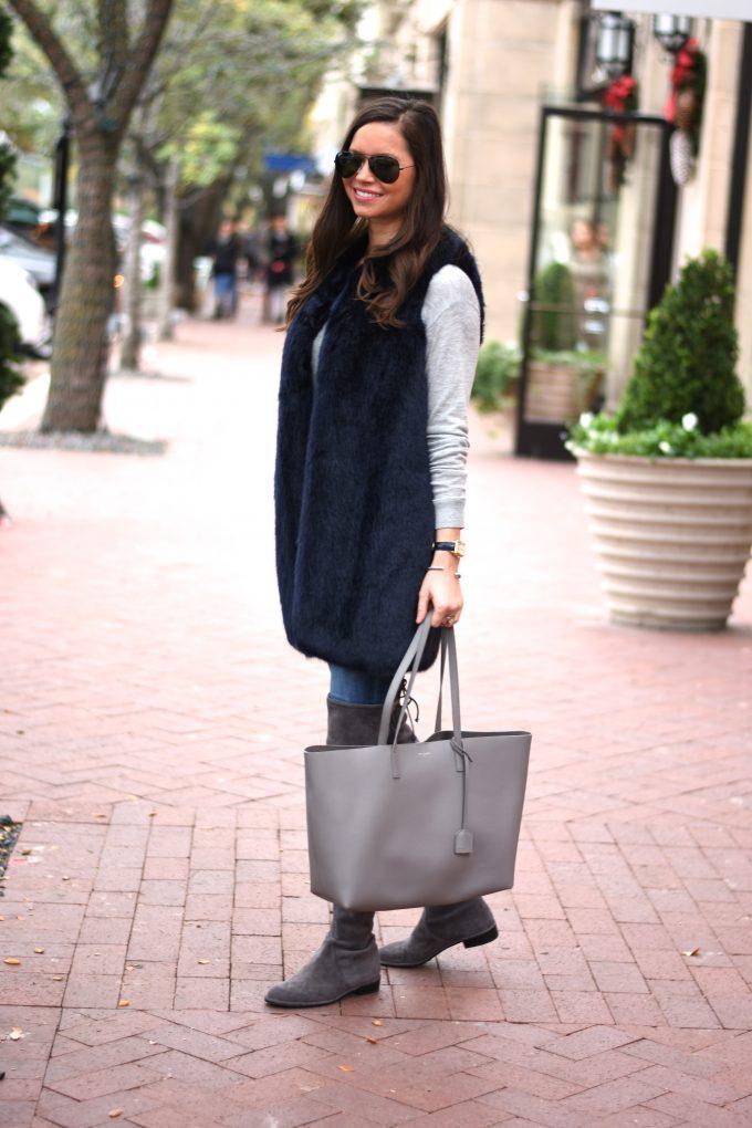 dark blue faux fur vest, grey tote bag, grey suede boots