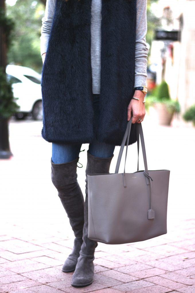 dark blue faux fur vest, grey tote bag, grey over the knee boots