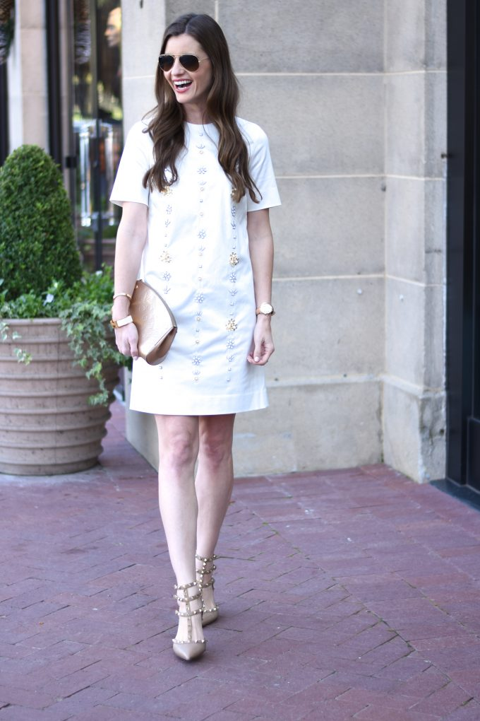 holiday party dress in winter white with embellishments on the front