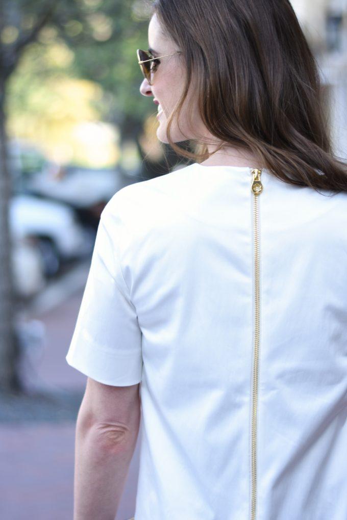 white dress wit exposed gold zipper back