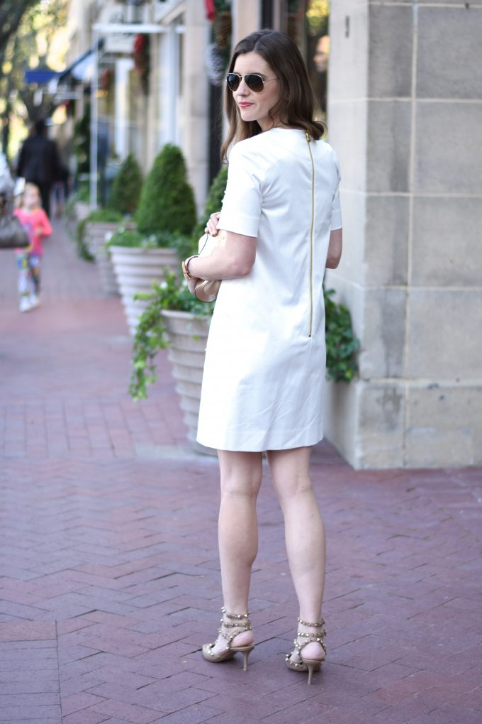 white dress with exposed gold zip back
