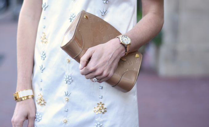 gold patent leather clutch, ladies watch with tan leather strap