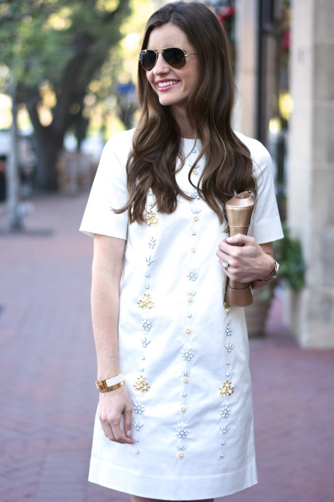 short white party dress, gold patent leather clutch