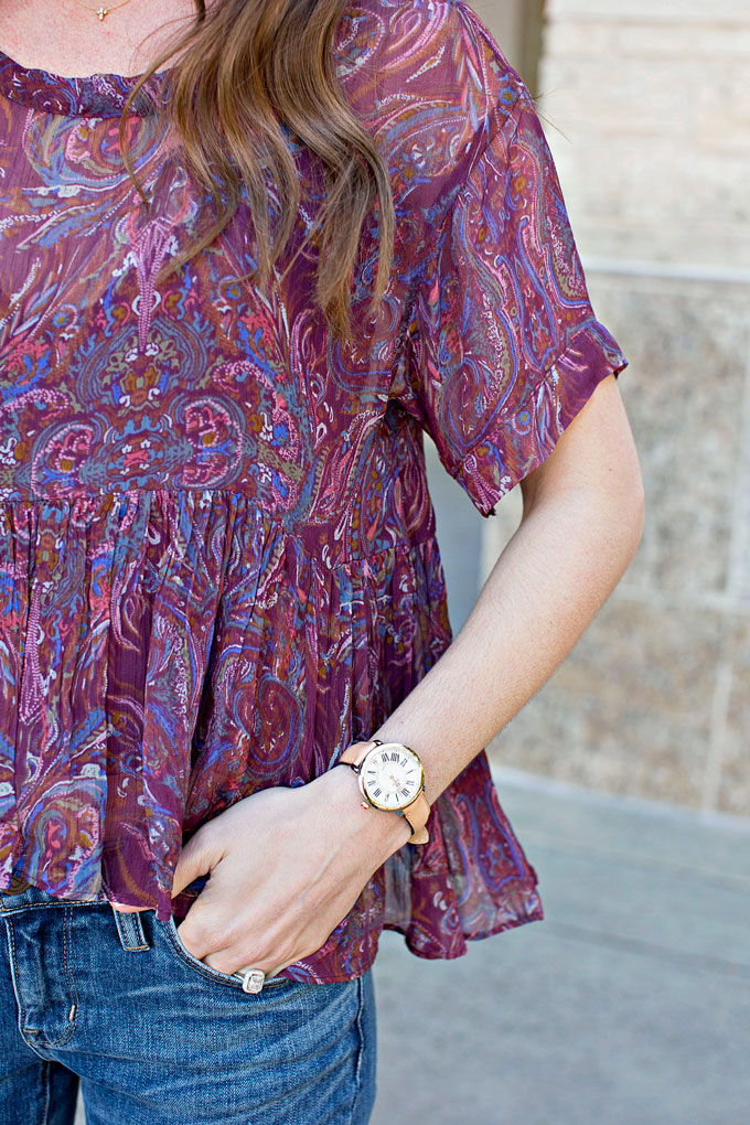 purple paisley top, ladies gold watch with tan strap